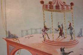 The Monkey Room mural was painted by John Spencer Churchill, his signature on the table by the carousel