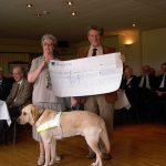 Chairman Brian Blakeney presenting cheque to Guide Dogs For The Blind 2004