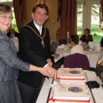 Deputy Mayor and his wife cutting anniversary cakes